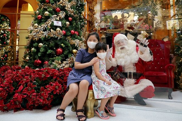 Santa Claus in George Posing with a children