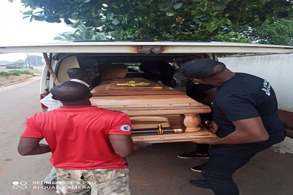 Undertakers pushing Prince Abuda's coffins into the vehicle