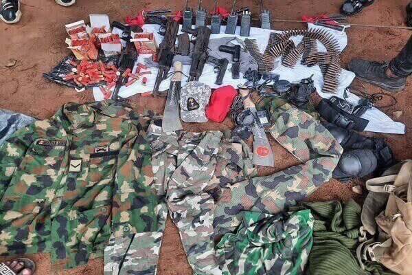 Guns, Ammunitions, Machetes and Military Camouflage recovered at the scene