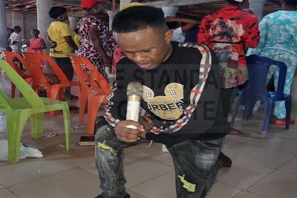 Pastor Anselm Idele in Church