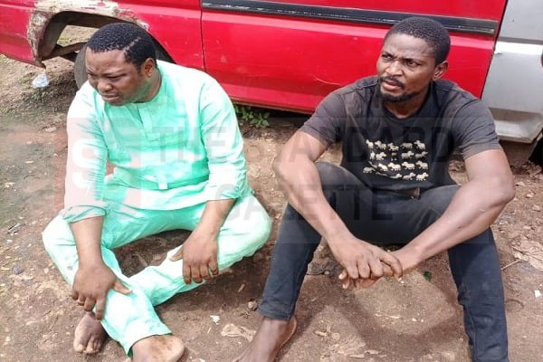 The two vigilante members arrested in Edo State after beating two police officers to stupor
